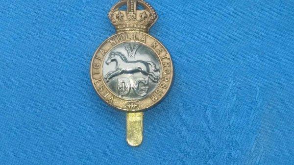 The 5th Dragoon Guards cap badge.