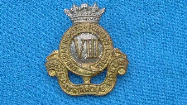 Princess Louises 8th Hussars cap badge.