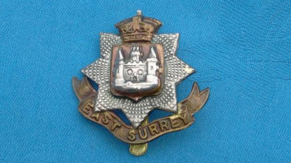 The East Surrey Regiment cap badge.