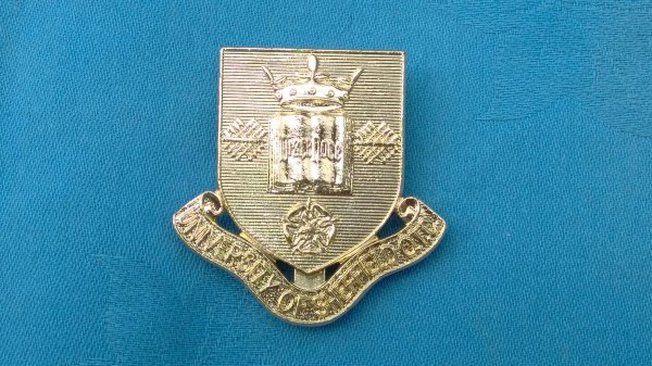 The University of Sheffield Officers Training Corp cap badge.