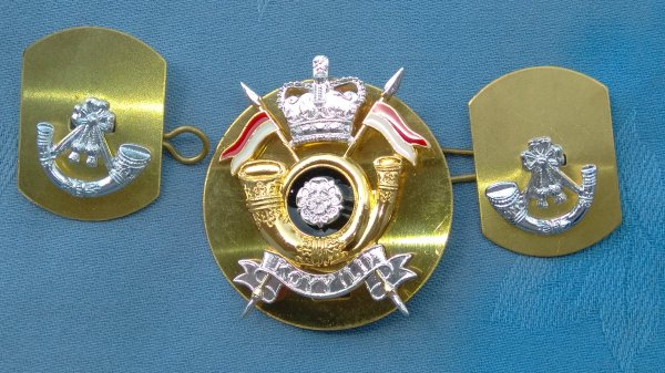 The Kings own Yorkshire Light Infantry Yeomanry cap badge/collar badges.