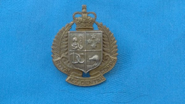 New Zealand Army Dental Corp cap badge.