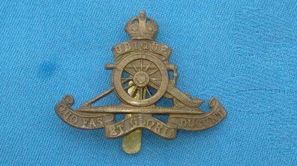 The Royal Artillery Beret cap badge.