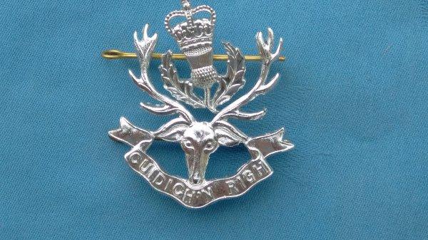 Queens own Highlanders cap badge.