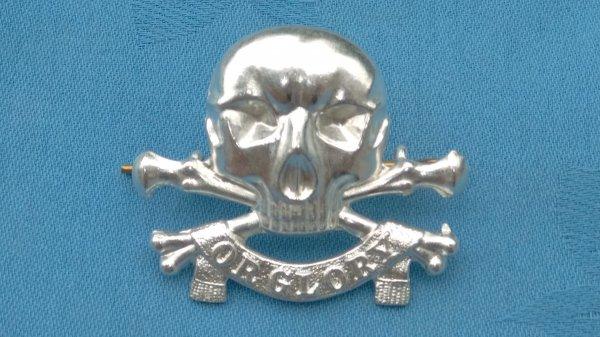 The 17th/21st Lancers cap badge.