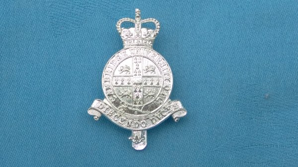 The Cambridge University Officers Training Corp cap badge.