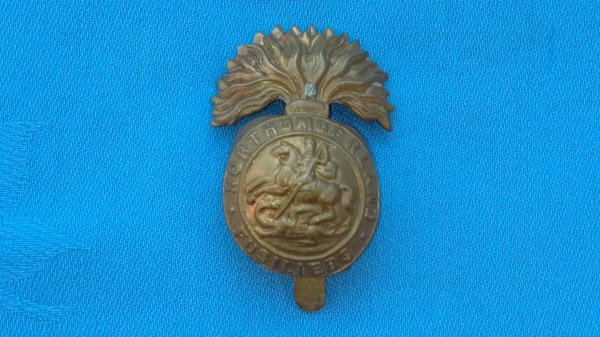 The Northumberland Fusiliers Cap badge.