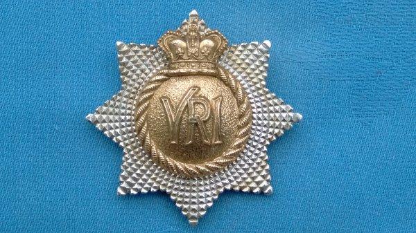 The Royal Canadian Regiment cap badge.