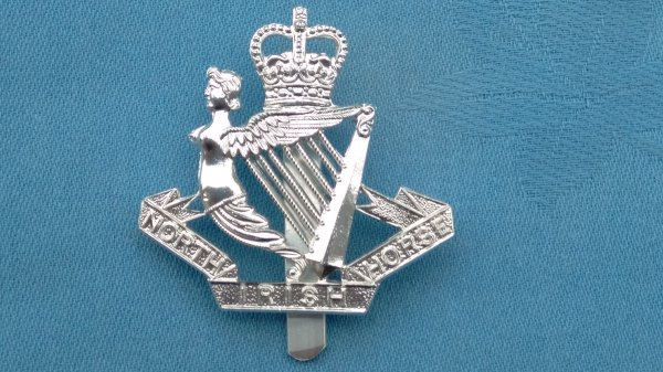 The North Irish Horse cap badge.