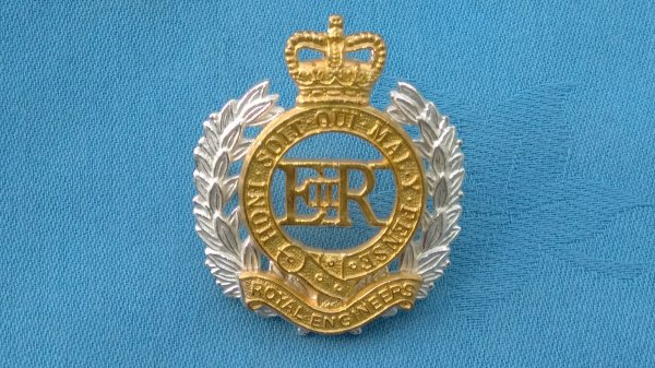 The Royal Engineers cap badge.