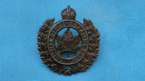 The Canadian Officers Training Corp cap badge.