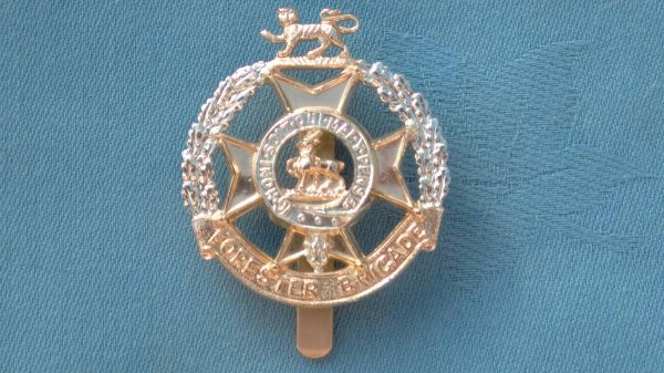 The Foresters Brigade cap badge.