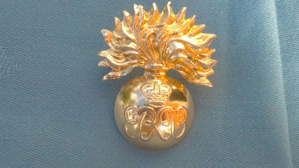 The Grenadier Guards Warrant Officers cap badge.