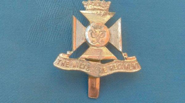 The Wiltshire Regiment cap badge.