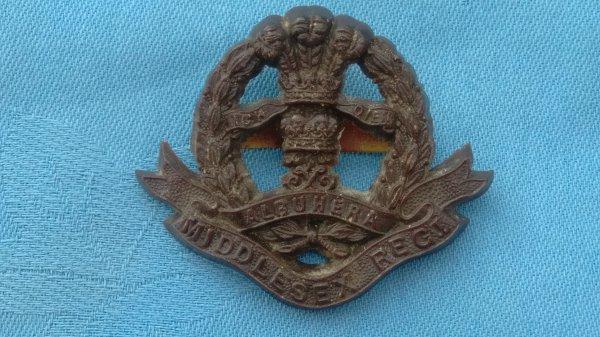 The Middlesex Regiment Plastic cap badge.