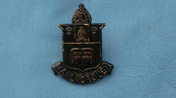 The Malborough College Officers Training Corp cap badge.