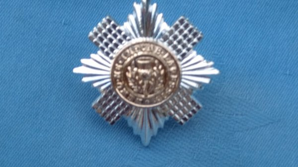 The Scots Guards NCOs cap badge.