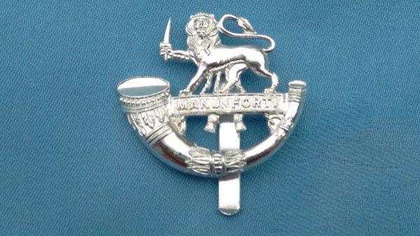 The Herefordshire Light Infantry cap badge.