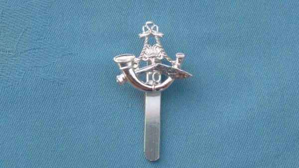 The 10th Gurkha Regiment cap badge.