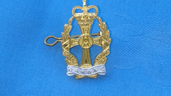 The Queen Alexandrias Royal Army Nursing Corp cap/collar badges.