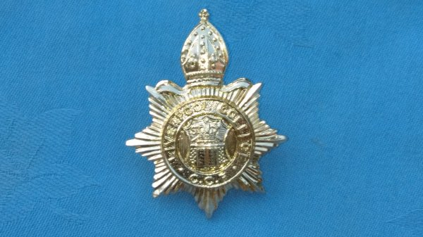 The Liverpool College Combined Cadet Force cap badge.