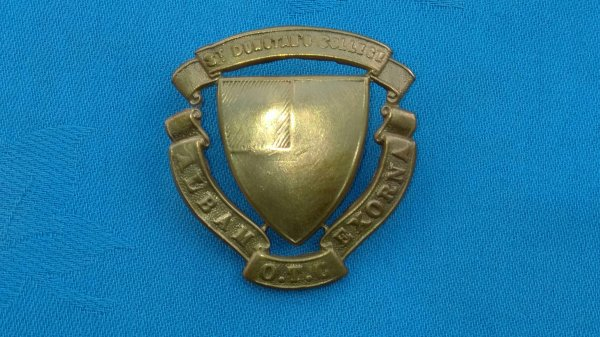 The St Dunstans College Officers Training Corp cap badge.