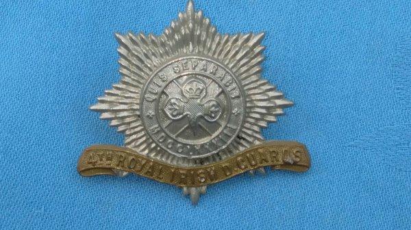 The 4th Dragoon Guards cap badge.