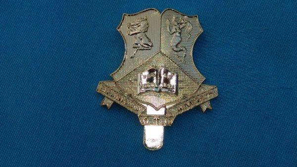 The Birmingham University Officers Training Corp cap badge.