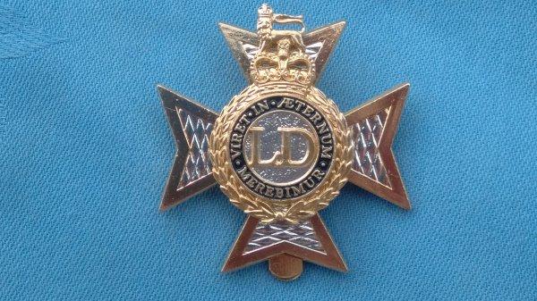 The Light Dragoons cap badge.