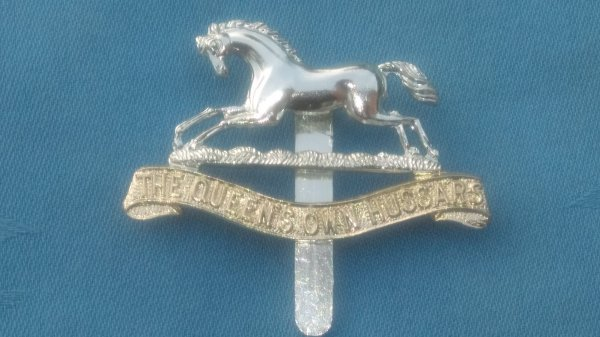 The Queens own Hussars cap badge.