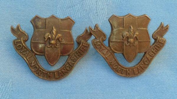 The Loyal North Lancashire Regiment collar badges.