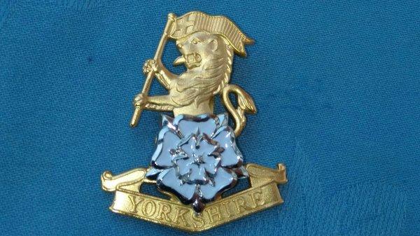 The Yorkshire Regiment cap badge.