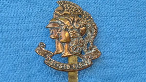 The 28th County of London Battalion.The Artists Rifle cap badge.