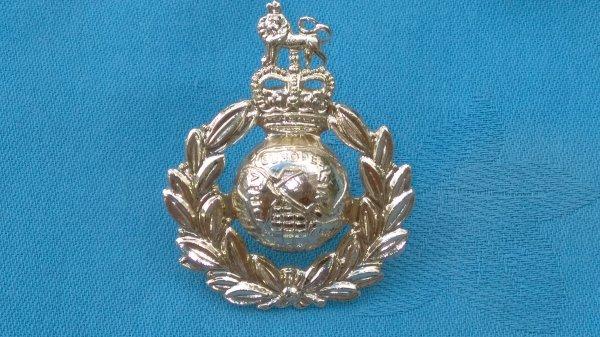 The Royal Marines cap badge.