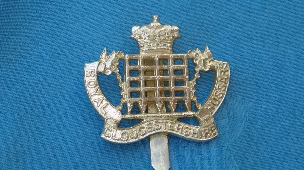 The Royal Gloucestershire Hussars cap badge.