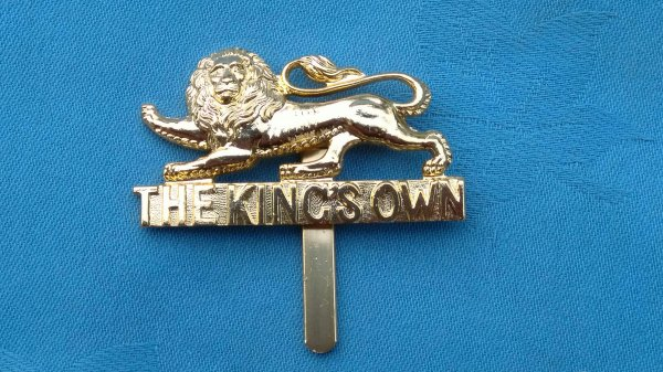 The Kings own Regiment cap badge.