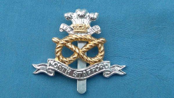 The North Stafford Regiment cap badge.