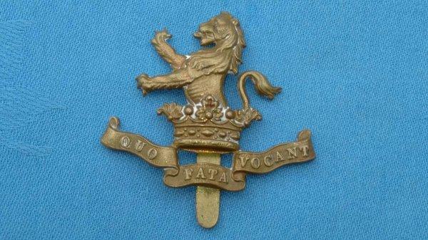 The 7th Dragoon Guards cap badge.