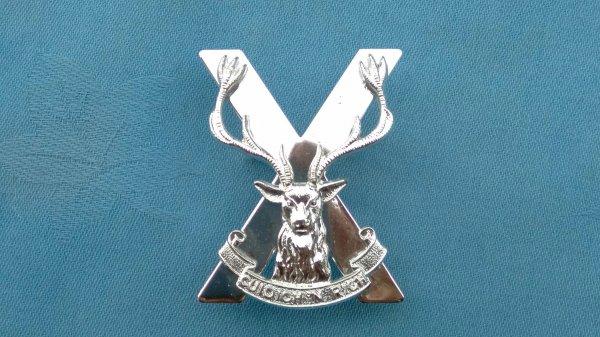 The Highland Brigade cap badge.