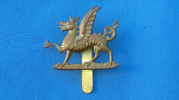 The 1st Battalion Monmouthshire Regiment cap badge.