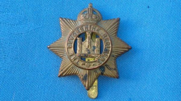 The Devonshire Regiment cap badge.