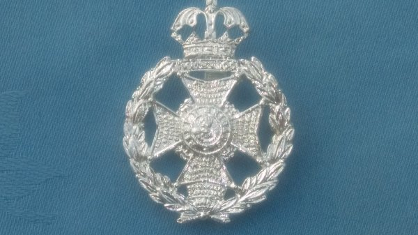 The Rifle Brigade cap badge.