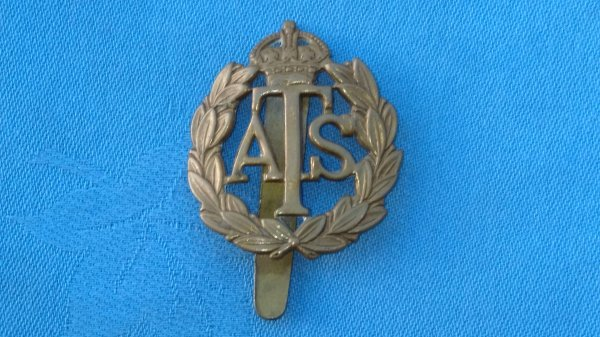 The Auxiliary Territorial Service cap badge.