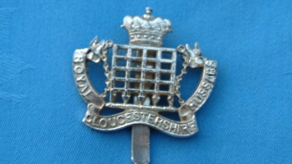 The Gloucestershire Hussars cap badge.