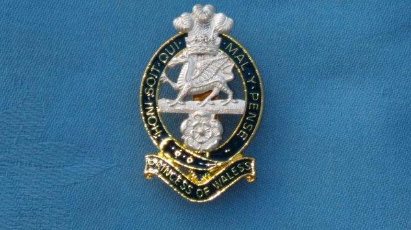 The Princess of Wales own Regiment cap badge.