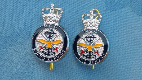 The Ministry of Defence Guard Service collar badges.