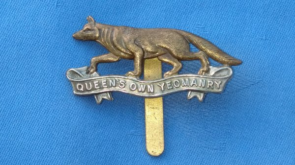 The Queens own Yeomanry cap badge.