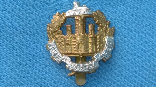 The Essex Regiment cap badge.