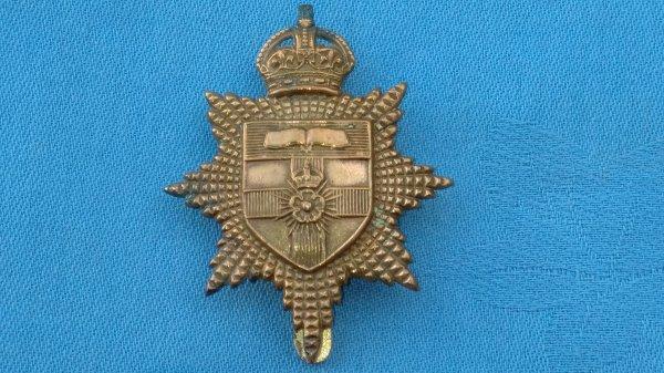 The London University Officers Training Corp cap badge.