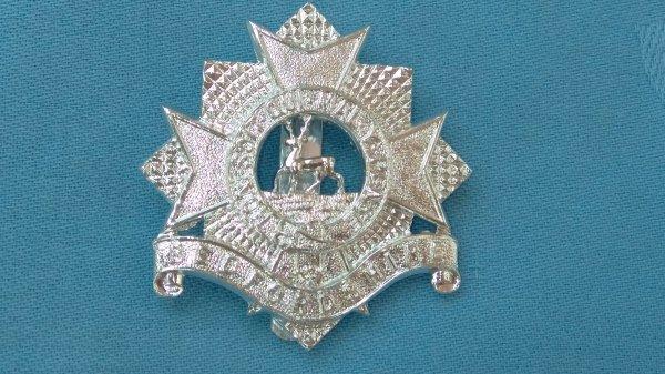 The Bedfordshire Territorials cap badge.